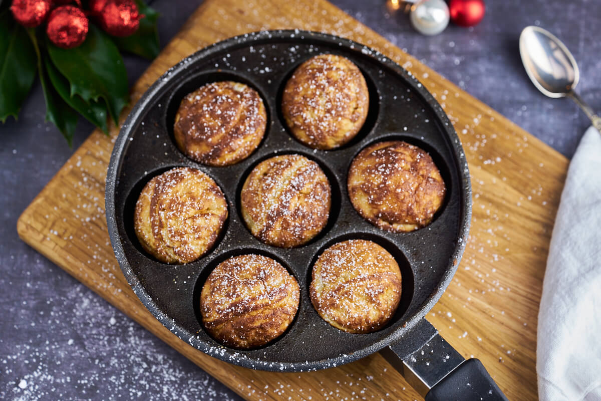 Round aebleskiver in old-fashioned ableskiver pan in cast ion